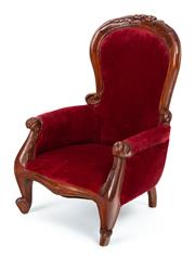 Sale 9015J - Lot 55 - A vintage Victorian style mahogany dolls chair late 1900s. The foliate carved and waisted back upholstered in red velvet. The scrol...