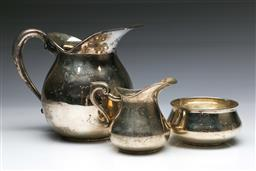 Sale 9093 - Lot 93 - Peruvian plata 925 Sterling Silver Three Piece Suite by Ind. Peruana (wt.645g) Incl. Two Jugs (one handle broken) and Open Sugar