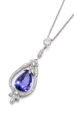 Sale 9123J - Lot 31 - AN 18CT WHITE GOLD TANZANITE AND DIAMOND PENDANT NECKLACE, featuring an articulating pear cut tanzanite of approx. 4.40ct on a leaf ...