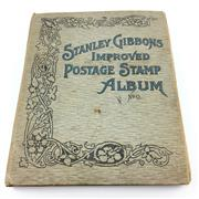 Sale 8618 - Lot 53 - Early Stamp Album with Pre & Post Federation Australia, British and Chinese Stamps. Stamps are cancelled & hinged, in Stanley Gibbon...