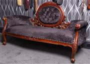 Sale 8761A - Lot 65 - A carved timber chaise with faux fur button back black upholstery W x 160cm D x 175cm, Height of back approx 1m