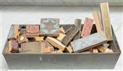 Sale 9060H - Lot 54 - A metal filing bin of elongated form containing a large array of printers blocks. Length 48cm
