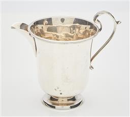 Sale 9085S - Lot 12 - George V Sterling Silver milk jug, hallmarked Birmingham 1914, Hardy Bros, with a scroll handle and raised over a circular foot, wei...
