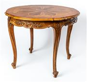 Sale 9015J - Lot 59 - An Italian walnut inlaid centre table C: 1880, inlaid with a central floral medallion with radiating looped panels extending to the ...