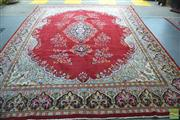 Sale 8416 - Lot 1019 - Persian Kerman Wool Carpet, with pendant rosette on a fuchsia field (400 x 300cm)