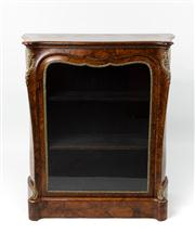 Sale 8716A - Lot 23 - An antique French figured walnut bombe shaped pier cabinet C: 1870. The canted corners with bronze shell and folliates with beaded s...