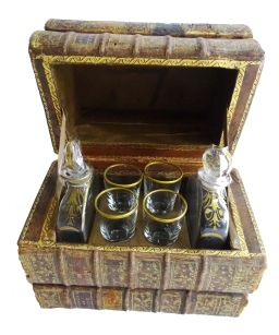 Sale 9150J - Lot 58 - An Art Deco French secret book stack tantalus, 2 bottle & 4 glasses some small wear to edges, 15 x 17 x 10cm