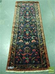 Sale 8500 - Lot 1041 - Persian Kurdish wool runner, with angular floral ornaments on a dark blue field (298 x 113cm)