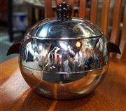 Sale 8320 - Lot 728 - 1950s American stainless steel globular ice bucket and cover embossed with a frieze of penguins, and with bakelite handles; and pair...