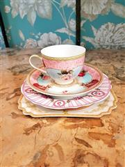 Sale 8500A - Lot 74 - A pretty pink floral 4 piece cup & saucer set - Condition: As New