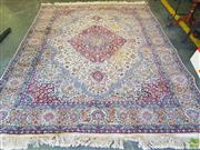 Sale 8576 - Lot 1028 - Fine Indian Wool Carpet, with concentric blue & red medallions and pendants, on a cream field with floral arabesques  (275 x 210cm)