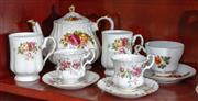 Sale 8926K - Lot 65 - A group of Rose decorated ceramics, including Saddler teapot and Royal Albert cup sets