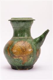 Sale 9015C - Lot 725 - Possibly Yuan green glazed sancai kendi (H23cm)