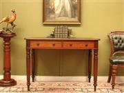 Sale 8925H - Lot 16 - An antique William IV flame mahogany two-drawer desk on ring turned legs, with gilt embossed leather blotter, Height 76cm, Width 107...