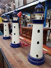 Sale 8934 - Lot 1018 - Set of Three Timber Light Houses
