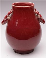 Sale 9078 - Lot 30 - Sang de boeuf Hu shaped vase with double deer head handles (H27cm)