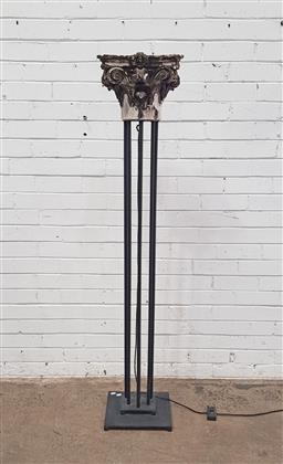 Sale 9129 - Lot 1096 - Wrought iron floor lamp with ornate plaster top ex country trader (h164 x w32 x d21cm)