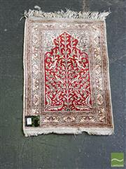 Sale 8460 - Lot 1066 - Small Kayseri Silk Carpet, the red mihrab with tree-of-life and birds (58 x 41cm)