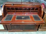 Sale 8774 - Lot 1088 - Victorian Mahogany Cylinder Bureau, enclosing pigeon-holes & slide-out writing surface, above two arched panel doors (2 keys in office)