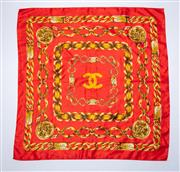 Sale 8760F - Lot 76 - A Chanel silk scarf printed with concentric chains on a red ground