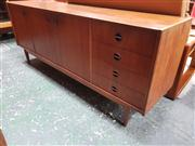 Sale 8822 - Lot 1110 - Parker Sideboard with 3 Doors, 4 Drawers and Catseye Handles