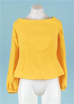 Sale 9092F - Lot 90 - A CARLA ZAMPATTI YELLOW CREPE BLOUSE, with beautiful sleeves and zip to back, Size 12