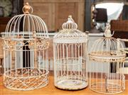 Sale 9060H - Lot 64 - Three graduated metal birdcages. Height of largest 50cm