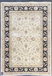 Sale 8822 - Lot 1259 - Cream and Black Tone Machine Made Carpet (230 x 160cm)