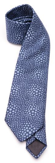 Sale 9080F - Lot 43 - AN HERMES SILK TIE IN BOX; blue with pale blue spots.