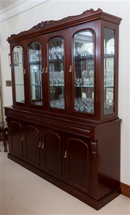 Sale 9155H - Lot 39 - A carved display cabinet with four glass insert doors over four lower doors, all opening to reveal shelved interior Height 210cm x W...