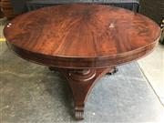 Sale 9031 - Lot 1091 - Early 19th Century Flame Mahogany Supper Table, on turned pedestal with tri-form base & scrolled feet (h:73 x d:120cm)