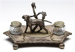 Sale 9246 - Lot 16 - A silverplated desk set depicting a dog under foliage together with two sterling silver lidded ink wells (W:26cm) (inkwells do not fit)