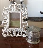 Sale 8902H - Lot 173 - An elaborately carved white painted timber photo frame together with a merry go round money box
