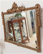 Sale 8926K - Lot 53 - A moulded gilt gesso mirror with rope twist border, H 68 x W 88cm
