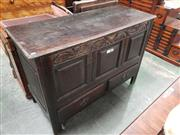 Sale 9031 - Lot 1033 - George III Oak Mule Chest, with hinged top, foliate carved top rail, fielded panels & two drawers, on moulded stile legs