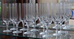 Sale 9155H - Lot 41 - A set of 11 Orrefors champagne flutes Height 19.5cm