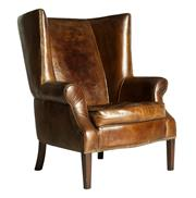 Sale 8599A - Lot 21 - A large statement leather wingback armchair, in hand aged leather, H 111 x W 91 x D 104cm