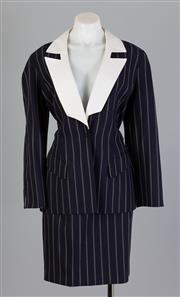 Sale 8661F - Lot 61 - A Thierry Mugler, Paris for Fred Hayman, Beverly Hills tailored pinstripe blazer with contrasting white lapels and a matching skirt,...