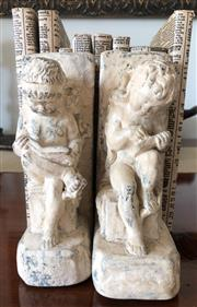 Sale 8902H - Lot 174 - A pair of plaster bookends in the form of cherubs reading books