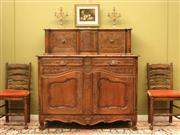 Sale 8925H - Lot 23 - A vintage French carved walnut sideboard with sliding doors above two drawers and a base cupboard, Height 144.5cm, Width 144cm, Dept...