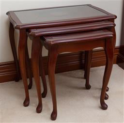 Sale 9155H - Lot 44 - A nest of three graduating tables with glass inserts. Tallest Height 47 x Width 56cm x Depth 36cm