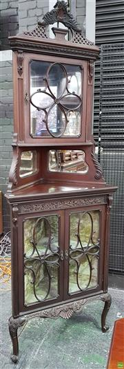 Sale 8559 - Lot 1024 - Late Victorian/ Edwardian Carved Mahogany Corner Cabinet, with pierced cornice, astragal door cabinet with multiple mirrors & two as...