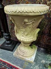 Sale 8576 - Lot 1030 - Pair of Large Concrete Urn Form Jardinieres, with leaf capped lip, frieze of classical figures & square bases
