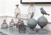 Sale 8866H - Lot 5 - A group of wirework birdcages and two bird form finials