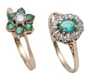 Sale 9012 - Lot 312 - TWO HALLMARKED 9CT GOLD EMERALD AND DIAMOND CLUSTER RINGS; an oval cut emerald (chipped), surrounded by 12 single cut diamonds, size...