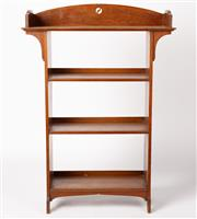 Sale 9048A - Lot 79 - An English arts and crafts oak free standing open bookcase, the top shelf with cut out yin-yang style motif. (h:128 x w:92 x d:32cm)...