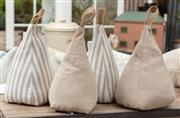Sale 9060H - Lot 72 - A group of four fabric pyramid form door stops in neutrals. H26cm