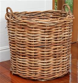 Sale 9134H - Lot 46 - An oversize twin handled woven cane basket. Height 75cm