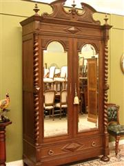 Sale 8925H - Lot 28 - An antique French Henri II style walnut armoire with barley twist columns and bevelled mirrors (can be dismantled for transport), He...