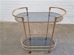 Sale 9157 - Lot 1024 - Art deco style drinks trolley with smoky glass shelves (h83 x w65 x d38cm)